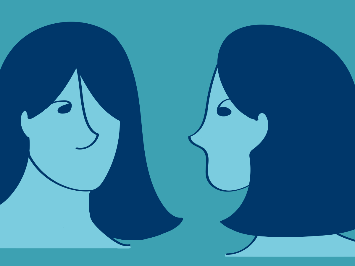 Two faces of the same woman staring at each other.