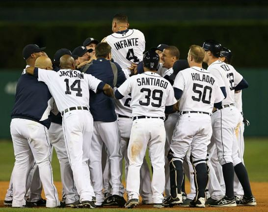 Tigers second baseman Omar Infante celebrates with teammates after driving in Don Kelly to beat the visiting White Sox on Saturday (Photo courtesy of the Detroit Tigers)
