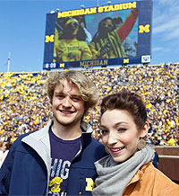 Meryl Davis and Charlie White being honored at a Michigan football game. (Courtesy of http://davis-white.ice-dance.com)