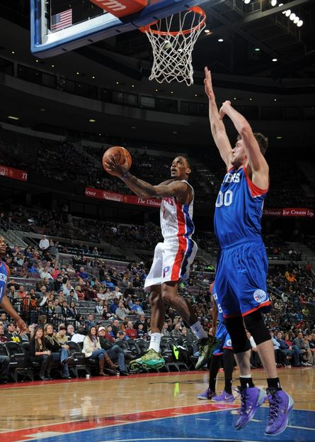 Brandon Jennings drives to the basket against Philadelphia's Spencer Hawes in the second quarter of Saturday's game. The Pistons defeated the 76ers, 113-96 at the Palace of Auburn Hills (Photo courtesy of Allen Einstein/Detroit Pistons)