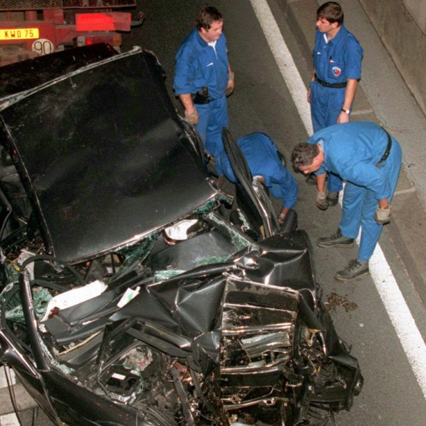 ** FILE ** Police services prepare to take away the damaged car in the Pont d'Alma tunnel in Paris in which Diana, Princess of Wales, and Dodi Fayed were traveling in this Sunday, Aug. 31, 1997 file photo. The British inquest into the death of Princess Diana and her companion Dodi Fayed opened Tuesday Oct. 2, 2007 with the selection of a jury and the aim of officially concluding how the couple came to die in the Paris car crash a decade ago. (AP Photo/Jerome Delay)
