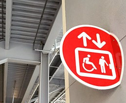 Accessible elevator sign near stadium stairs