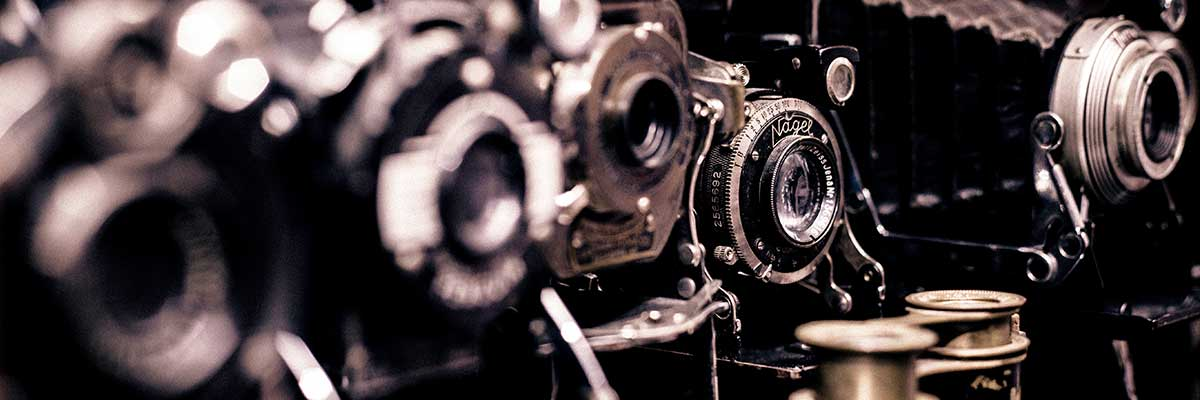 Line of antique cameras