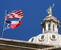 Closeup of Texas Capitol with Texas Flag and the Goddess of Liberty