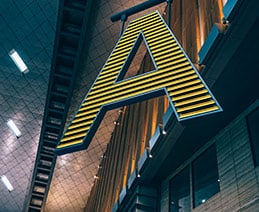"Abstract letter ""A"" hangs from industrial ceiling"