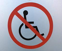 "Universal symbol of access (wheelchair icon) with ""Do Not"" symbol overlaid"