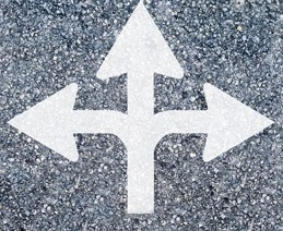 arrows on pavement pointing in three directions