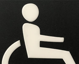 White Universal Symbol of Access on a black background.