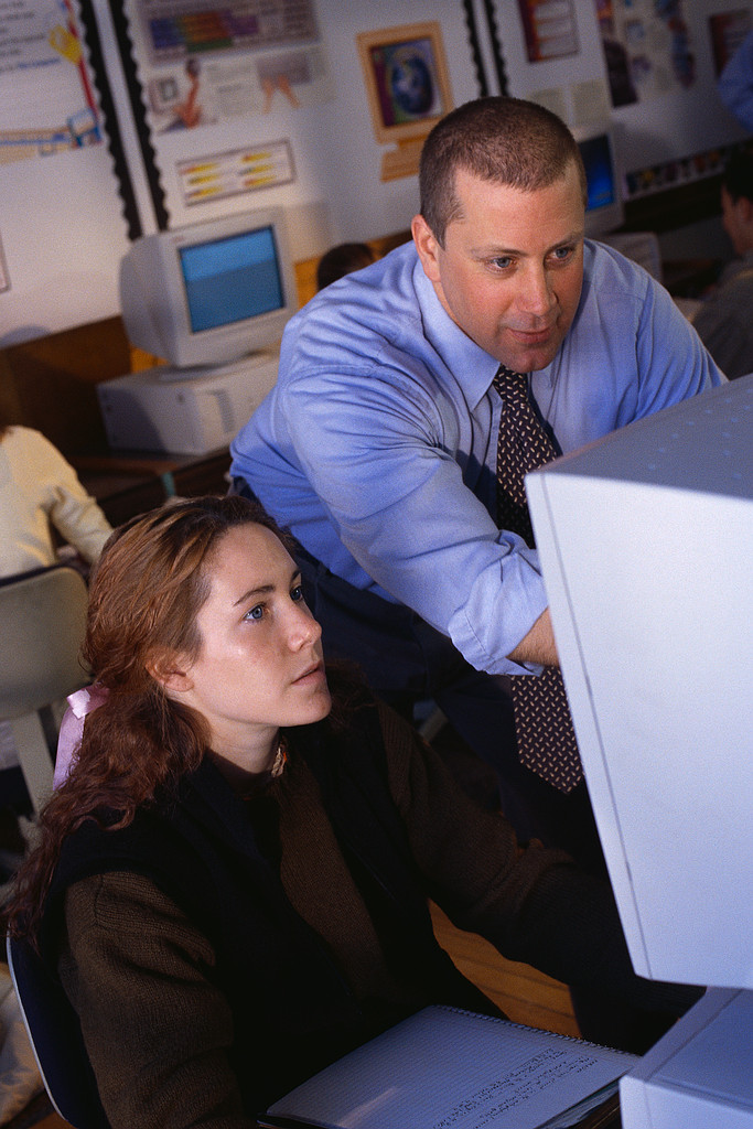 Teacher Helping Student at Computer ca. 2000