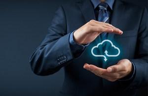 A man cupping a digital cloud computing symbol