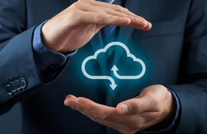 Hands holding an image representing cloud storage