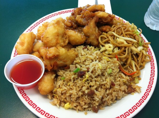 Chinese Food with sweet & sour chicken plus friend rice, lo mein noodles.