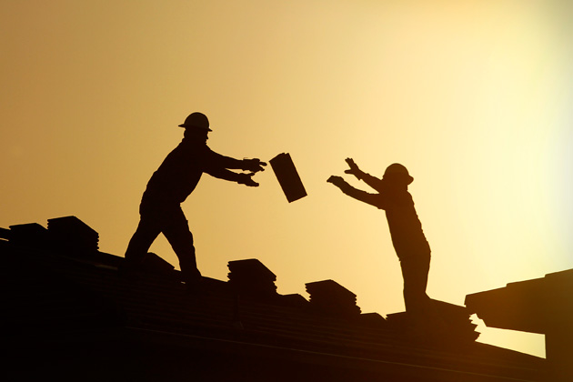construction workers tossing objects