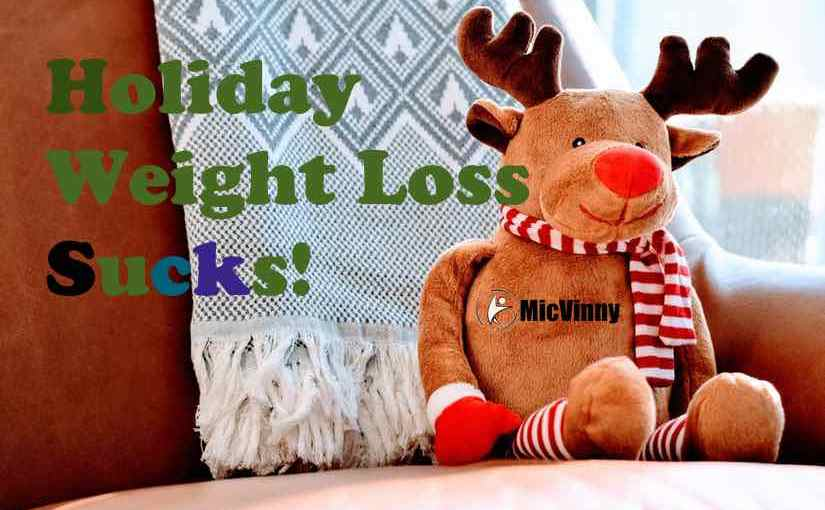 Holiday Weight Loss Sucks! with a reindeer stuff animal with MicVinny logo