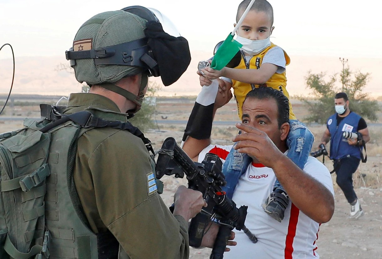 A Palestinian man argues with an Israeli soldier during a protest against Israel's plan to annex parts of the occupied West Bank, in Jordan Valley June 24, 2020