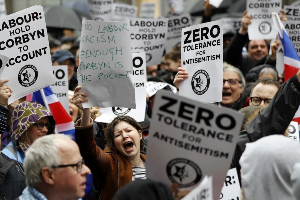 People demonstrate against alleged antisemitism in the UK Labour Party in 2018 (AFP)