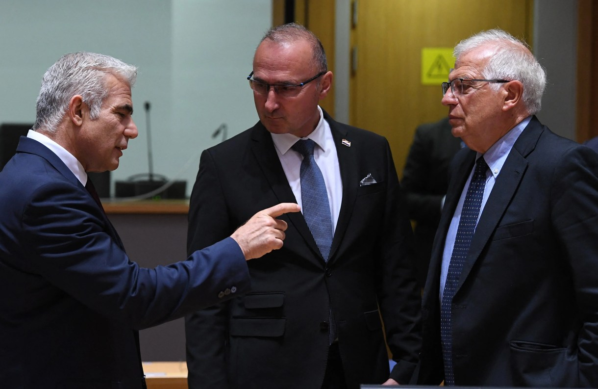 Israeli Foreign Minister Yair Lapid (L) talks with Crotian Foreign Minister Gordan Grilc Radman (C) and European High Representative of the Union for Foreign Affairs Josep Borrell (R) (AFP)
