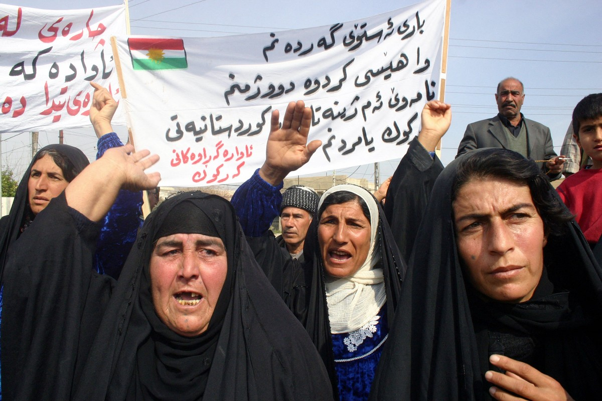 Kurdish women protest in the northern city of Kirkuk 06 March 2005, demanding the return of their properties and rights which were snatched away during the regime of ousted President Saddam Hussein (AFP)