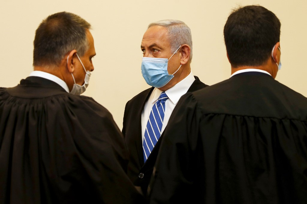 Netanyahu is pictured inside a Jerusalem courtroom as his corruption trial opens on 24 May (AFP)