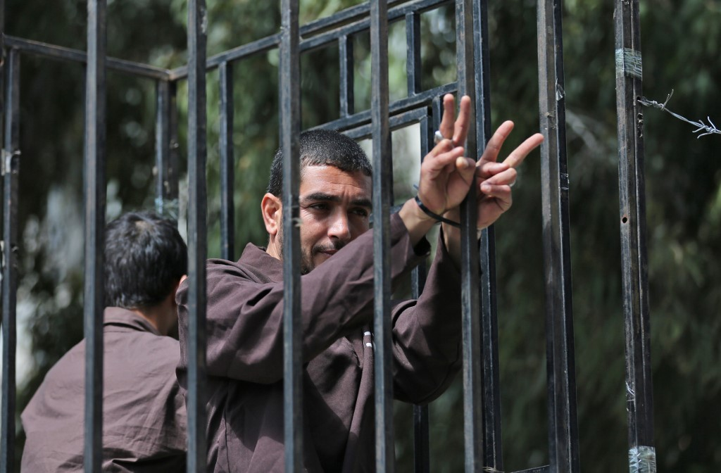 Demonstrators mark Palestinian Prisoners' Day on 17 April in Gaza City (AFP)