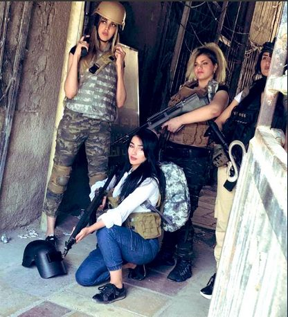 Four Iraqi women pose in PUBG clothes to protest ban (Twitter)