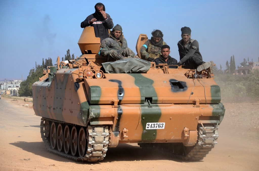 Rebel fighters backed by Turkey advance towards al-Bab, Syria, in 2017 (AFP)