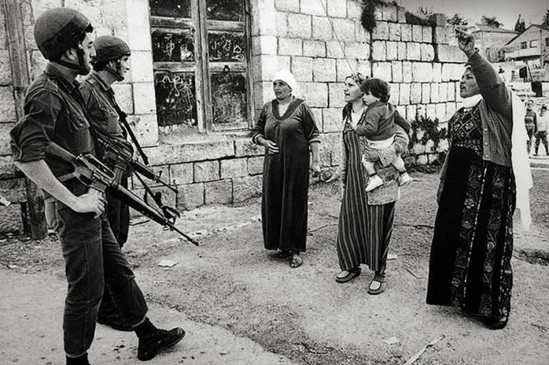 Women seen confronting Israeli troops in Gaza during the first intifada. After this photo was taken the women were assaulted and dispersed with truncheons and tear gas. Image by Robert Croma from maryscullyreports.com