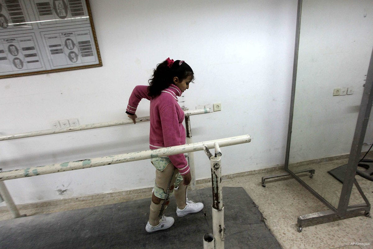 Dina Abu Sitta 16, Palestinian girl who lost her leg during an Israeli offensive, seen during rehabilitation sport in Gaza city, on December 03, 2012 [Ashraf Amra / ApaImages]