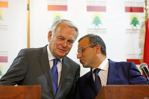 French Foreign Minister Jean Marc Ayrault (L) and Lebanonese Foreign Minister Gebran Basil (R)