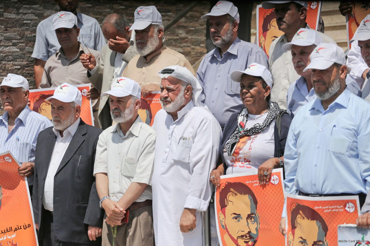 Gazans gather to show solidarity with hunger striking prisoners at the headquarters of The Palestinian Legislative Council, on August 4 2016