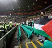 Palestinian flags flown in this photo taken during Celtic match despite UEFA threats.