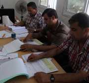 Palestinians from Central Elections Commission (CEO) work at Voter registration centers in Rafah in the southern Gaza strip on July 23, 2016