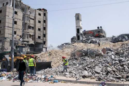 Funded by the United Nations Development Programme (UNDP), Palestinian workers clear the debris of a commercial centre which was destroyed by Israeli shelling during 2014's Operation 'Protective Edge'. Image taken in Rafah, southern Gaza Strip on April 20, 2015
