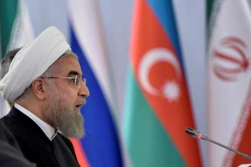 Iranian President Hassan Rouhani makes a speech during a signing ceremony after a meeting with Russian President Vladimir Putin and Azeri President Ilham Aliyev (not seen) in Baku, Azerbaijan, August 8, 2016