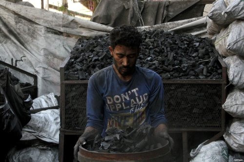 An Egyptian man sells coal at a market in Cairo, Egypt ahead of the Eid al-Adha festival on Sept. 11, 2016 [Amr Sayed/ApaImages]