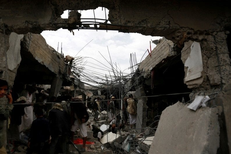 People gather at a building destroyed by Saudi-led airstrikes in the northwestern city of Amran, Yemen September 8 2016.