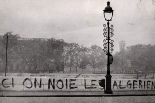 """""""Here we drown Algerians"""" sign on Saint-Michel Bridge in Paris in 1961. Dozens of bodies were later pulled from the River Seine. [Wikipedia]"""