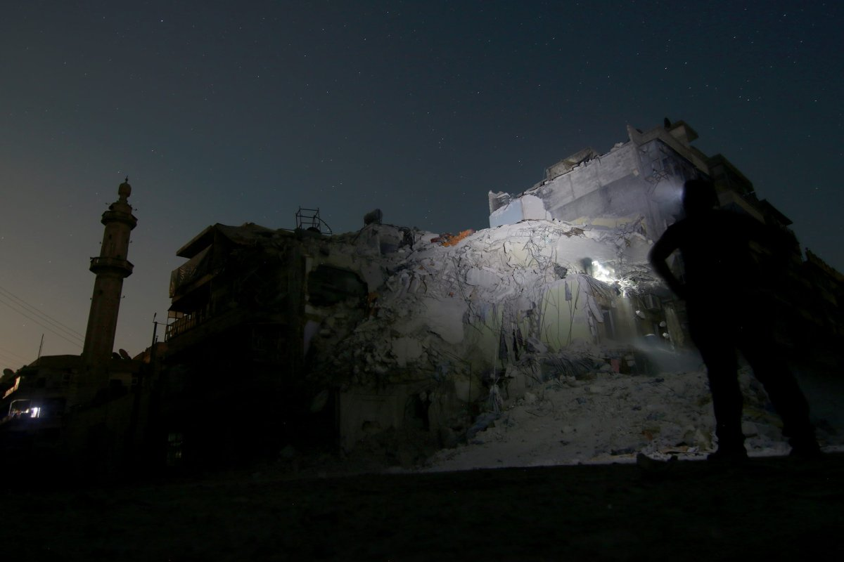 Wreckage of a building is seen after the Russian army carried out an airstrike over opposition controlled area in Syria [Jawad al Rifai / Anadolu Agency]