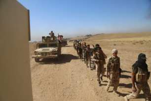 Iraqi Army and Hashd Al-Shaabi militias arrive at Saleh Village on October 20, 2016, liberating it from Daesh control. [Hemn Baban/Anadolu Agency]