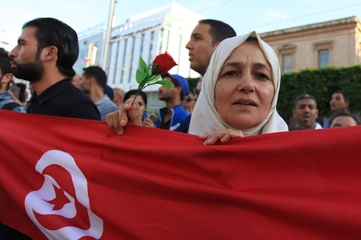 People hold Tunisian flags at the Habib Bourguiba street during the 189th anniversary of Tunisian flag in Tunis, Tunisia on October 22, 2016 [Yassine Gaidi/Anadolu Agency]