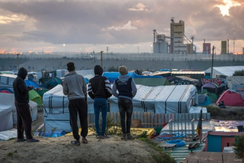 Refugees at the Calais 'jungle' camp in Calais, France on October 22, 2016 [Claire Thomas/Anadolu]