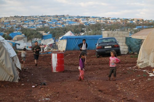 A view of a muddy ground tent city named Atme which is submerged due to the rain in Idlib, Syria on 1 November 2016. Syrian refugees flee from their homes to escape heavy Syrian regime and Russian airstrikes. ( Abdulghani Arian - Anadolu Agency )