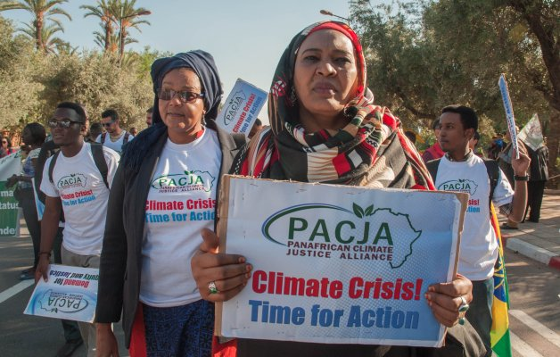 Activists hold banners at a demonstration for climate change and calling for environmental action in Marrakesh on the sidelines of the COP22 climate conference on November 13, 2016 [Jalal Morchidi/Anadolu Agency]