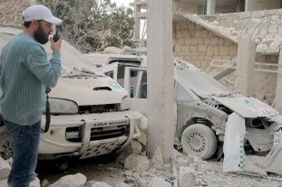 IDLIB, SYRIA - OCTOBER 13: A Syrian inspects the damage at a building after an airstrike hit a medical center in Binnis district of Idlib, Syria on October 13, 2016. ( Firas Faham - Anadolu Agency )
