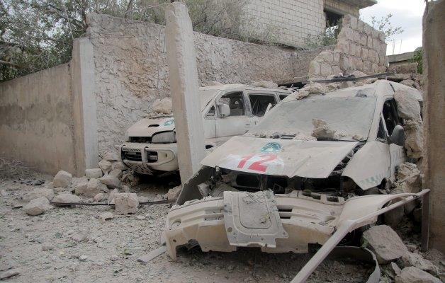 IDLIB, SYRIA - OCTOBER 13: Damaged ambulances are seen after an airstrike targeted a medical center in Binnis district of Idlib Syria on October 13, 2016. ( Firas Faham - Anadolu Agency )