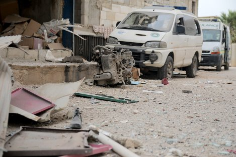 IDLIB, SYRIA - OCTOBER 13: Damaged vehicles are seen after an airstrike targeted a medical center in Binnis district of Idlib, Syria on October 13, 2016. ( Firas Faham - Anadolu Agency )