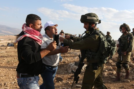 JERICHO, WEST BANK: Israeli security forces intervene Palestinian protesters with real and plastic bullets and tear gas during a demonstration at the symbolic region named 'Yasser Arafat Village' in Al-Agvar region of Jericho, West Bank on November 17, 2016. ( Issam Rimawi - Anadolu Agency )