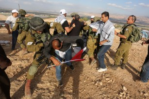 JERICHO, WEST BANK - NOVEMBER 17: Israeli security forces take the Palestinian protesters into custody at the symbolic region named 'Yasser Arafat Village' in Al-Agvar region of Jericho, West Bank on November 17, 2016. ( Issam Rimawi - Anadolu Agency )
