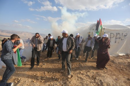 JERICHO, WEST BANK - NOVEMBER 17: Israeli security forces intervene Palestinian protesters with real and plastic bullets and tear gas during a demonstration at the symbolic region named 'Yasser Arafat Village' in Al-Agvar region of Jericho, West Bank on November 17, 2016. ( Issam Rimawi - Anadolu Agency )