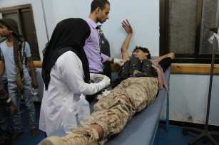 TAIZ, YEMEN - NOVEMBER 17: A wounded man takes medical treatment at the es Sevre hospital after he was injured during the clashes between People's Resistance Forces, loyal to President of Yemen Abd Rabbuh Mansur Hadi and Houthi forces in Taiz province in Taiz, Yemen on November 17, 2016. ( Abdulnasser Alseddik - Anadolu Agency )